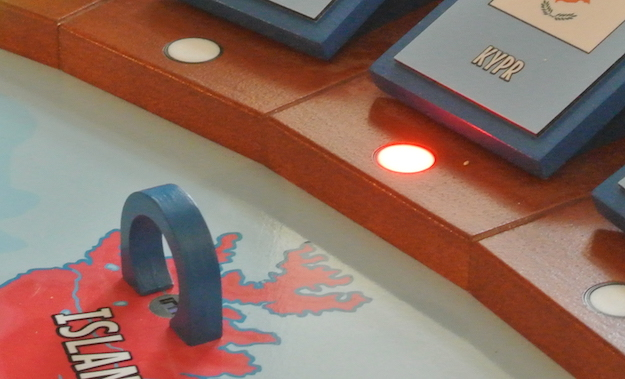 This picture shows detail of wooden gate, IR photo-interrupter with plastic adapter and RGB LED with national flag.
